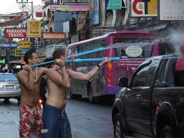 Songkran-2nd-Road, people shooting water at car